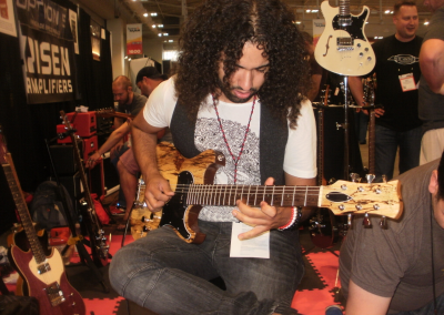 Musician John Souki plays the The P.H.A.T. System Acoustic Tremolo
